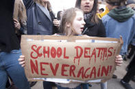 <p>A young girl holds a sign in Paris. (Photo: Getty Images) </p>