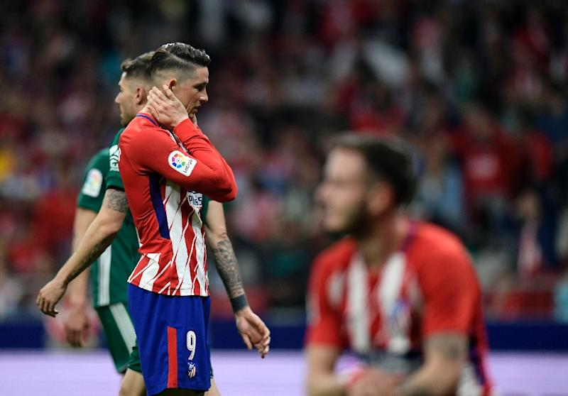 It was a frustrating night for Fernando Torres (L) and Atletico Madrid against Betis