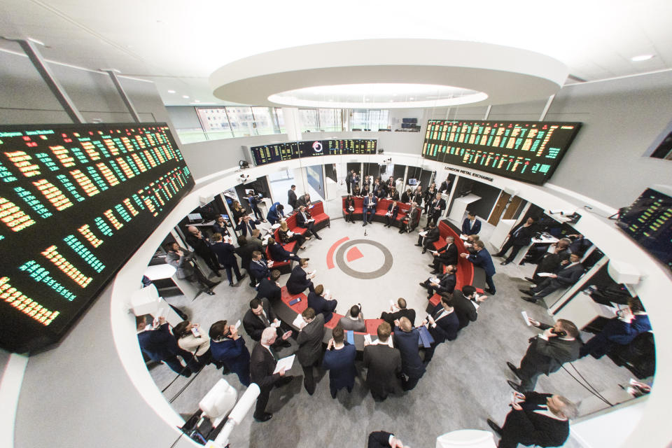 Traders during an open outcry trading session in 'The Ring' at the London Metal Exchange in London. Photo: Matt Crossick/ EMPICS PA