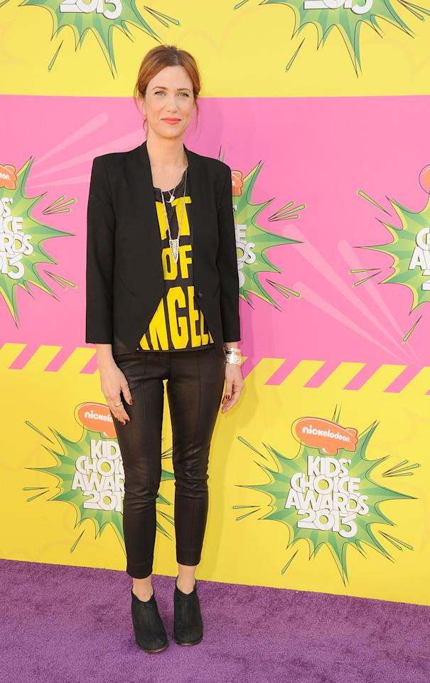 Kristen Wiig goes for pant-and-blazer combo. She keeps it young and fresh with a statement tee.