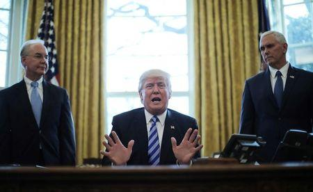 President Trump reacts to the AHCA health care bill being pulled by Congressional Republicans before a vote as he appears with Secretary of Health and Human Services Tom Price (L) and Vice President Mike Pence (R) in the Oval Office of the White House in Washington, U.S., March 24, 2017. REUTERS/Carlos Barria