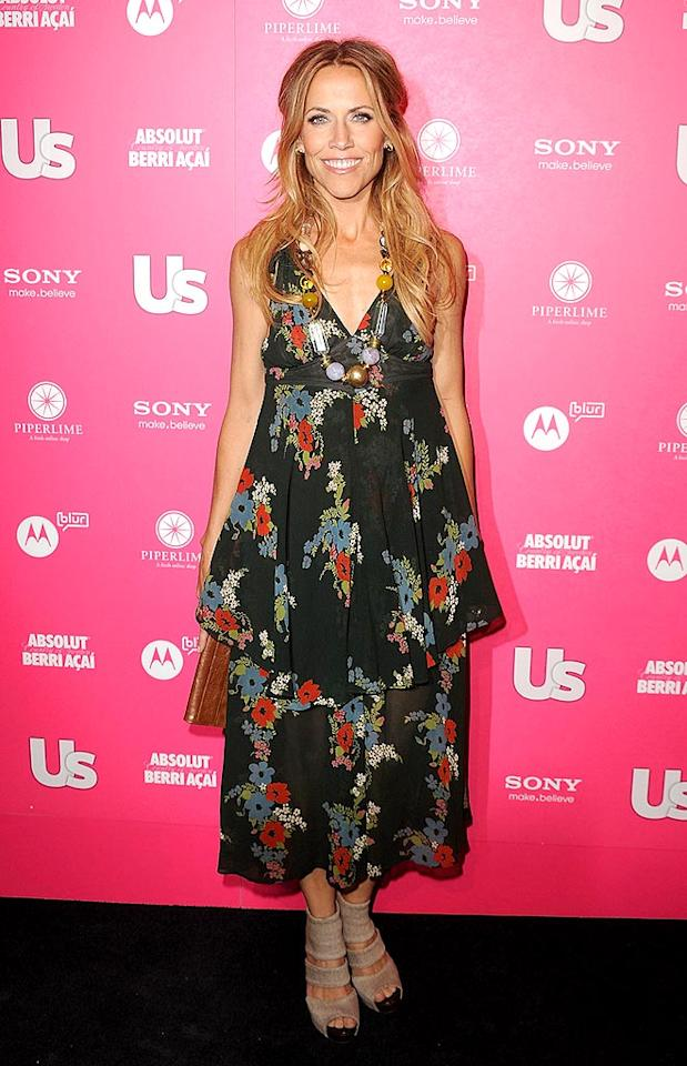 "Sheryl Crowe, who received <i>Us Weekly's</i>' ""Trendy Traditionalist"" title, was all smiles in a rather unflattering floral vintage Ossie Clark frock. Jason Merritt/<a href=""http://www.gettyimages.com/"" target=""new"">GettyImages.com</a> - April 22, 2010"