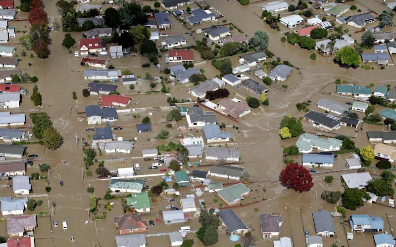 Flooded streets of the North Island town of Edgecumbe in New Zealand - Credit: Andrew Warner/AP