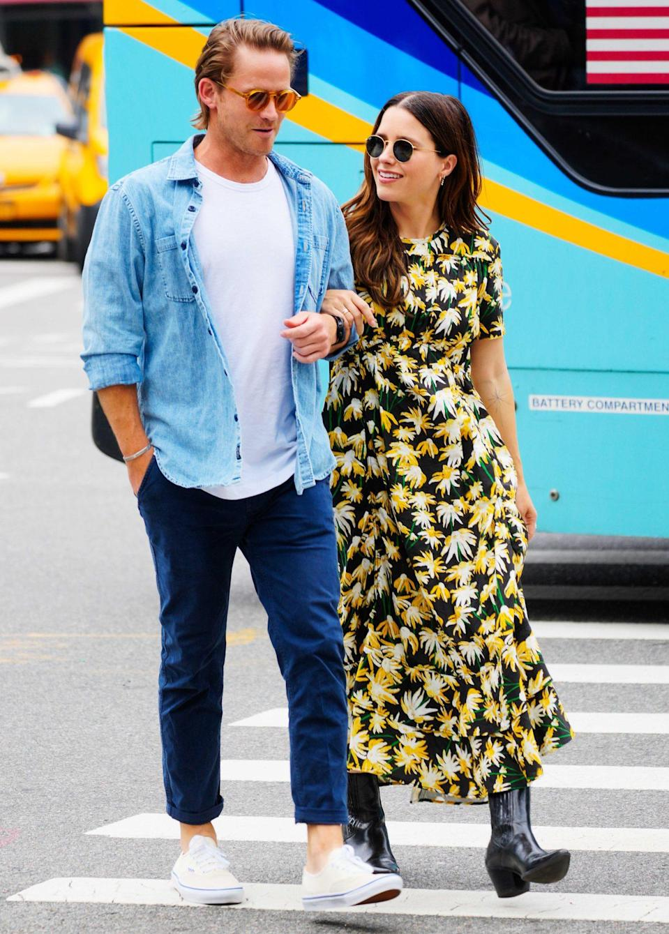 <p>Grant Hughes and Sophia Bush link arms during their walk through N.Y.C. on June 20. </p>