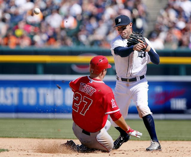 Detroit Tigers second baseman Ian Kinsler, right, turns the ball after getting a force out on Los Angeles Angels' Mike Trout, in the sixth inning of a baseball game Sunday, April 20, 2014, in Detroit. Kinsler made the double play, throwing out Albert Pujols at first. (AP Photo/Duane Burleson