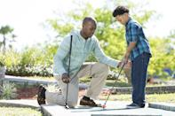 <p>If your partner is a golfer, get crafty in the backyard by setting up your own mini golf course. Print out some scorecards online and get ready to get competitive. </p>