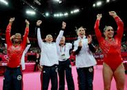 <p>Gabrielle Douglas, Kyla Ross, McKayla Maroney Maroney and Jordyn Wieber of the United States celebrate during the final rotation in the Artistic Gymnastics Women's Team final on Day 4 of the London 2012 Olympic Games at North Greenwich Arena on July 31, 2012 in London, England. (Photo by Ronald Martinez/Getty Images) </p>