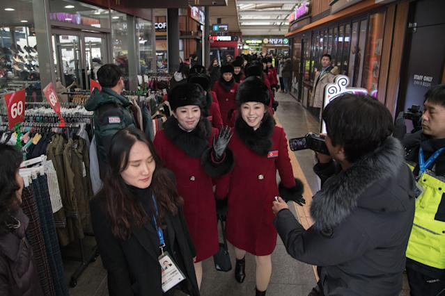 <p>North Korean cheerleaders arrive at a rest stop, or service station, as their bus convoy carrying a 280-member delegation on its way to the 2018 Pyeongchang winter Olympic games, makes its way past Gapyeong on February 7, 2018. </p>