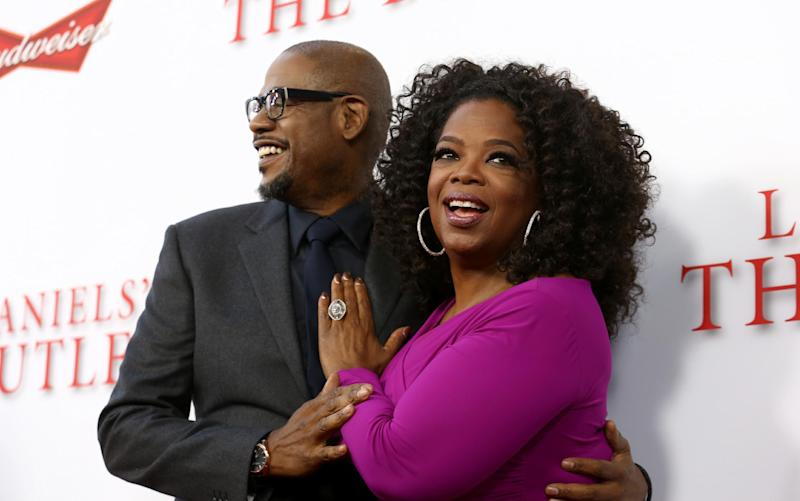 "FILE - In this Aug. 12, 2013 file photo, Forest Whitaker, left, and Oprah Winfrey arrive at the premiere of ""Lee Daniels' The Butler"" in Los Angeles. When ""Lee Daniels' The Butler,"" Winfrey's first feature since ""Beloved,"" hit No. 1 in its debut last weekend, she brought out a purple Hula Hoop she uses for special occasions. (Photo by Matt Sayles/Invision/AP, File)"