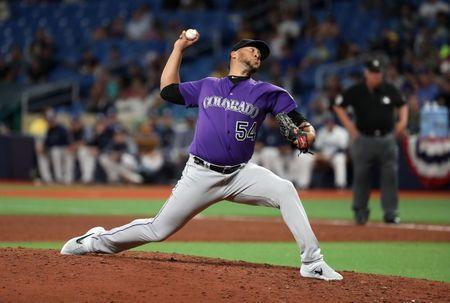FILE PHOTO: Apr 2, 2019; St. Petersburg, FL, USA; Colorado Rockies pitcher Guillermo Heredia (54) throws a pitch against the Tampa Bay Rays during the sixth inning at Tropicana Field. Mandatory Credit: Kim Klement-USA TODAY Sports