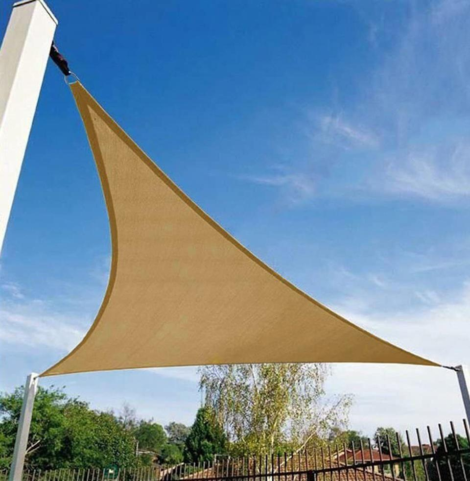 """It can get way too hot outside, and sometimes you need a little more UV protection on your patio. This fabric comes in many sizes, so you can cover and cool down most of your chairs and tables.<br /><br /><strong>Promising review:</strong>""""My pool is awesome when it gets into the 100s of degrees here in California.<strong>We decided to grab a 20x20x20 triangle and holy cow does it do a number on the backyard! Not only does it keep my pool better shaded, but it also keeps the sun off of my back patio during the hottest part of the day.""""</strong>—<a href=""""https://amzn.to/2PcMmgy"""" target=""""_blank"""" rel=""""nofollow noopener noreferrer"""" data-skimlinks-tracking=""""5580838"""" data-vars-affiliate=""""Amazon"""" data-vars-href=""""https://www.amazon.com/gp/customer-reviews/R1A83Q7FG405HD?tag=bfgenevieve-20&ascsubtag=5580838%2C24%2C33%2Cmobile_web%2C0%2C0%2C1159960"""" data-vars-keywords=""""cleaning,fast fashion"""" data-vars-link-id=""""1159960"""" data-vars-price="""""""" data-vars-product-id=""""16176933"""" data-vars-retailers=""""Amazon"""">Amazon Customer</a><br /><br /><strong>Get it from Amazon for<a href=""""https://amzn.to/3vej1lq"""" target=""""_blank"""" rel=""""nofollow noopener noreferrer"""" data-skimlinks-tracking=""""5580838"""" data-vars-affiliate=""""Amazon"""" data-vars-asin=""""B07H9NZ5G1"""" data-vars-href=""""https://www.amazon.com/dp/B07H9NZ5G1?tag=bfgenevieve-20&ascsubtag=5580838%2C24%2C33%2Cmobile_web%2C0%2C0%2C1159963"""" data-vars-keywords=""""cleaning,fast fashion"""" data-vars-link-id=""""1159963"""" data-vars-price="""""""" data-vars-product-id=""""16176934"""" data-vars-product-img=""""https://m.media-amazon.com/images/I/51f7+jtrVRL._SL500_.jpg"""" data-vars-product-title=""""Shade&Beyond 12'x12'x12' Sun Shade Sail Triangle Canopy Grey Outdoor UV Sunshade Sail for Patio Yard Backyard Garden Lawn"""" data-vars-retailers=""""Amazon"""">$24.99+</a>(available in six sizes and 12 colors).</strong>"""
