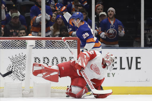 New York Islanders' Brock Nelson (29) celebrates as Detroit Red Wings goaltender Jimmy Howard (35) reacts after Nelson scored a goal during the first period of an NHL hockey game Tuesday, Jan. 14, 2020, in Uniondale, N.Y. (AP Photo/Frank Franklin II)