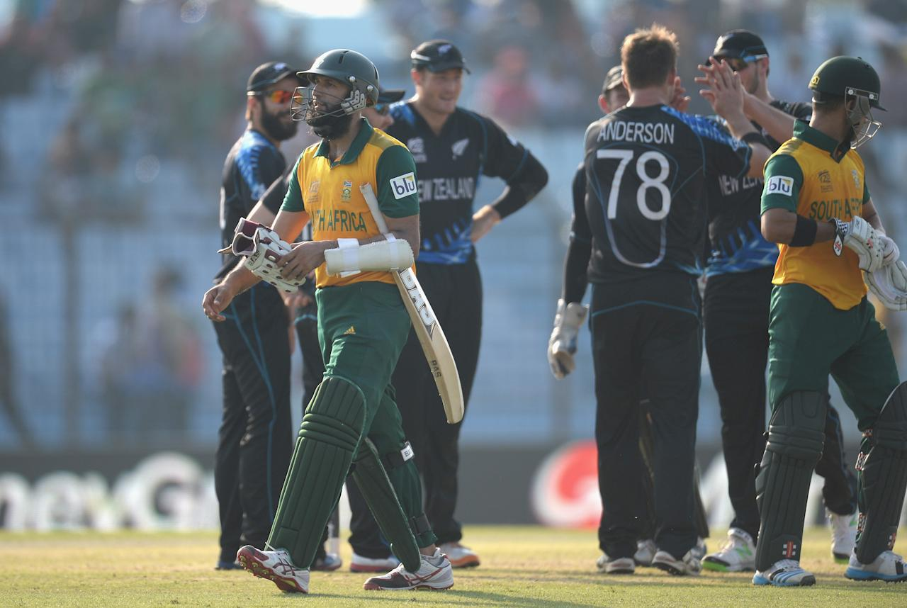 CHITTAGONG, BANGLADESH - MARCH 24:  Hashim Amla of South Africa leaves the field after being caught and bowled by Corey Anderson of New Zealand during the ICC World Twenty20 Bangladesh 2014 Group 1 match between New Zealand and South Africa at Zahur Ahmed Chowdhury Stadium on March 24, 2014 in Chittagong, Bangladesh.  (Photo by Gareth Copley/Getty Images)