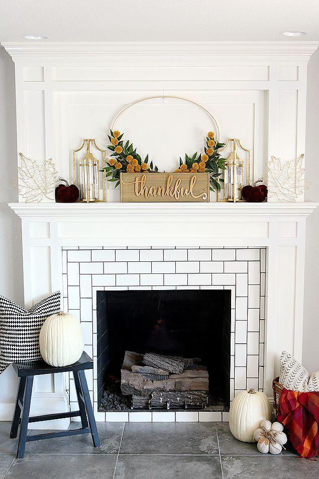 """<p>Create a seasonal focal point on your Thanksgiving mantel with this unique wreath. Your guests won't believe that those yellow """"flowers"""" are actually pom-poms!</p><p><strong>Get the tutorial at <a href=""""https://eighteen25.com/pretty-fall-mantel/"""" rel=""""nofollow noopener"""" target=""""_blank"""" data-ylk=""""slk:Eighteen 25"""" class=""""link rapid-noclick-resp"""">Eighteen 25</a>.</strong></p><p><strong><a class=""""link rapid-noclick-resp"""" href=""""https://www.amazon.com/Caydo-Pieces-Embroidery-Adjustable-Wholesale/dp/B07N6H5FVV/?tag=syn-yahoo-20&ascsubtag=%5Bartid%7C10050.g.2063%5Bsrc%7Cyahoo-us"""" rel=""""nofollow noopener"""" target=""""_blank"""" data-ylk=""""slk:SHOP EMBROIDERY HOOPS"""">SHOP EMBROIDERY HOOPS</a><br></strong></p>"""