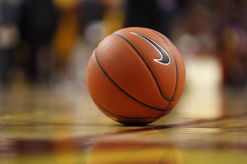 A basketball sits on the court during the first half of an NCAA college basketball game between Iowa State and Northern Illinois, Tuesday, Nov. 12, 2019, in Ames, Iowa. (AP Photo/Charlie Neibergall)