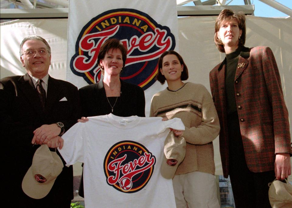 Indiana Fever COO Kelly Krauskopf (second from left) with Indiana Pacers President Donnie Walsh, Fever player Stephanie McCarty and interim head coach Ann Donovan in 1999. (AP Photo/Tom Strattman, File)