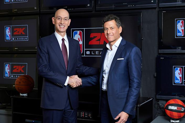 NBA Commissioner Adam Silver, left, and Take-Two CEO Strauss Zelnick pose for a photo at the NBA headquarters in New York, N.Y. on Feb. 8, 2017, during the announcement of the NBA 2K eLeague.