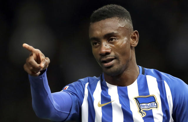 FILE - In this Wednesday, Sept. 20, 2017 file photo, Hertha's scorer Salomon Kalou celebrates his side's 2nd goal during the German Bundesliga soccer match between Hertha BSC Berlin and Bayer 04 Leverkusen in Berlin, Germany. Kalou is facing criticism for broadcasting a live stream showing social distancing measures being flaunted. The Ivory Coast striker brought his phone with him Monday, May 4, 2020 as he fist-bumped teammates in greeting, clapped hands with fellow forward Vedad Ibisevic, complained about a pay-cut, and burst in on another teammate apparently being tested for the new coronavirus.(AP Photo/Michael Sohn, file)