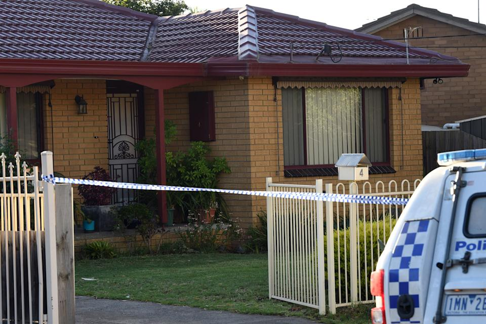 Police tape up at the Tullamarine home where the mum and three children were found dead.