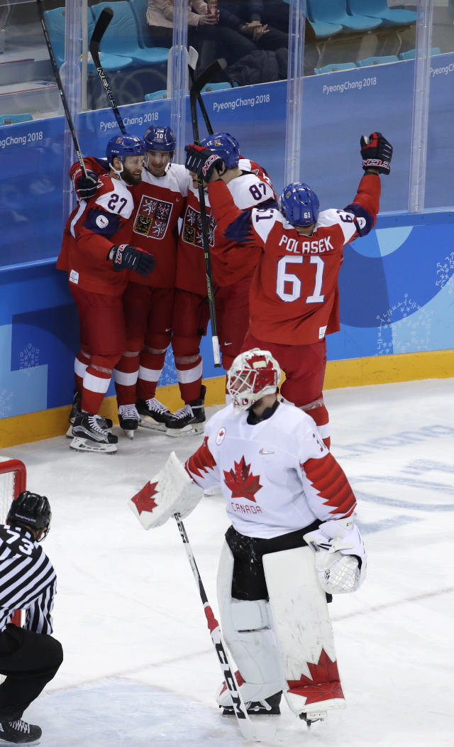 Martin Ruzicka (27), of the Czech Republic, celebrates with his teammates after scoring a goal against Canada during the first period of the men's bronze medal hockey game at the 2018 Winter Olympics in Gangneung, South Korea, Saturday, Feb. 24, 2018. (AP Photo/Julio Cortez)
