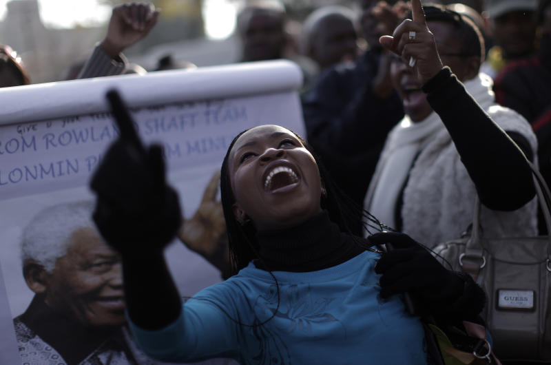 A well wisher chants prayers in support of former South African President Nelson Mandela at the entrance to the Mediclinic Heart Hospital where Mandela is being treated in Pretoria, South Africa, Saturday, June 29, 2013. (AP Photo/Muhammed Muheisen)