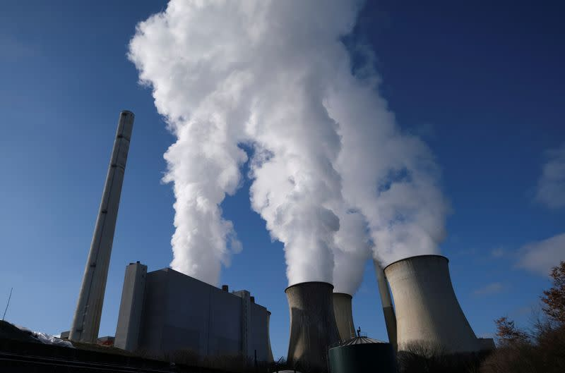 FILE PHOTO: Steam rises from the cooling towers of the lignite power plant complex of German energy supplier and utility RWE in Neurath