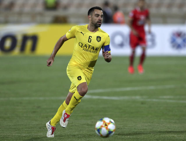 FILE - In this file photo dated Monday, May 20, 2019, Qatar's Al-Sadd player Xavi Hernandez, former Barcelona and Spain midfielder, controls the ball during an AFC Champions League match at the Azadi stadium in Tehran, Iran. Spain great Xavi Hernandez said Saturday Jan. 11, 2020, that for now he is committed to coaching his team in Qatar amid rumours that former club Barcelona has probed him about becoming its next coach. (AP Photo/Vahid Salemi, FILE)