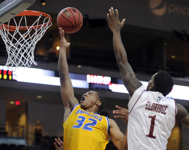 Cal State Bakersfield's Brandon Barnes (32) shoots against New Mexico State's DK Eldridge during the first half of an NCAA college basketball game in the semifinals of the West Athletic Conference men's tournament Friday, March 14, 2014, in Las Vegas. (AP Photo/David Becker)