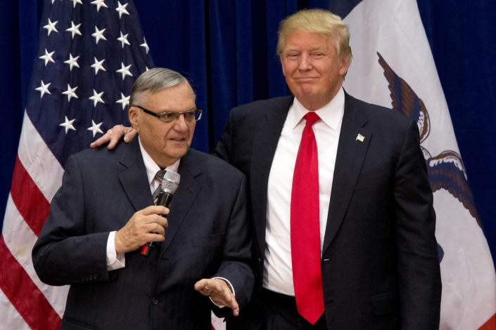 In this 2016 photo, Donald Trump is joined by Maricopa County, Ariz., Sheriff Joe Arpaio at an Iowa campaign event. Trump says he may grant a pardon to Arpaio following his recent conviction in federal court. (AP Photo/Mary Altaffer, File)