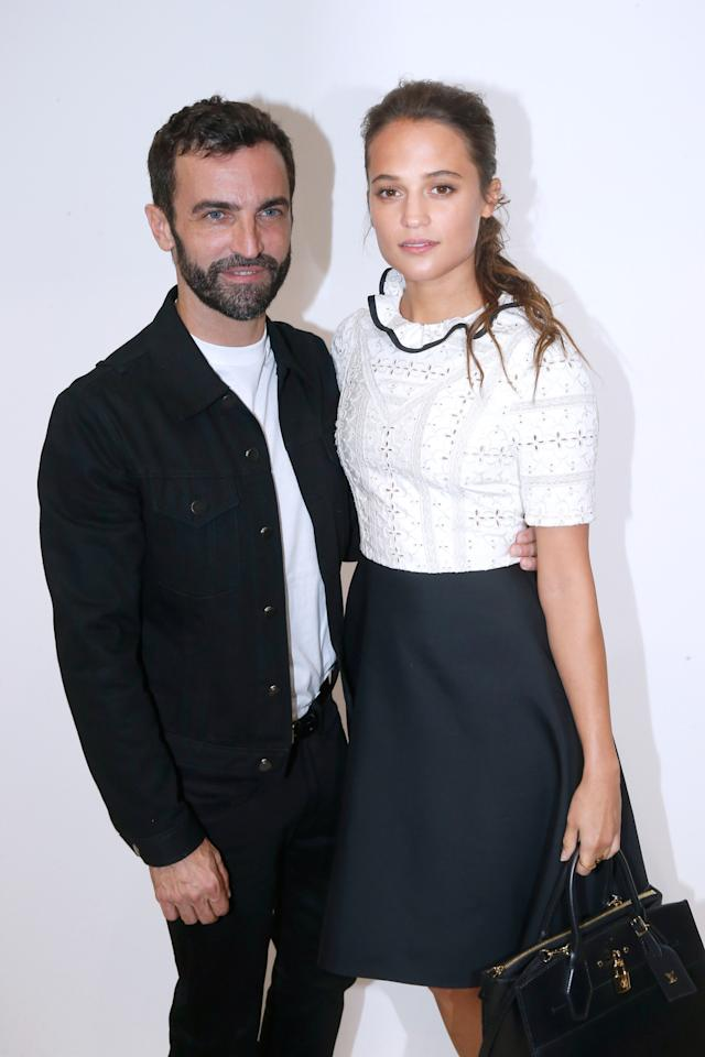 <p>The designer and one of his many muses pose for a photo backstage. <i>Photo: Getty Images</i></p>