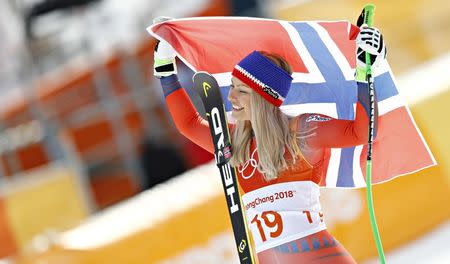 Alpine Skiing - Pyeongchang 2018 Winter Olympics - Women's Downhill - Jeongseon Alpine Centre - Pyeongchang, South Korea - February 21, 2018 - Silver medallist Ragnhild Mowinckel of Norway celebrates with the Norwegian flag during the flower ceremony. REUTERS/Kai Pfaffenbach