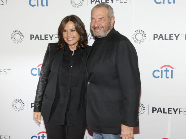 """FILE - This Oct. 13, 2014 file photo shows Mariska Hargitay, left, and Dick Wolf, at the PaleyFest New York """"Law & Order: SVU"""" panel discussion in New York. The show's 21st season premieres on Sept. 26. (Photo by Andy Kropa/Invision/AP, File)"""