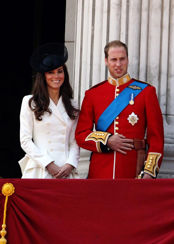 <p>On the balcony, Kate stood next to her husband, William. Kate wore a white Alexander McQueen coat dress here with a black hat by Sylvia Fletcher for Lock & Co.</p>