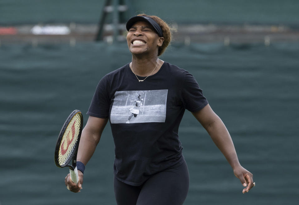 USA's Serena Williams reacts, during a practice session, ahead of the Wimbledon Tennis Championships, in London, Sunday, June 27, 2021. (David Gray/Pool Photo via AP)