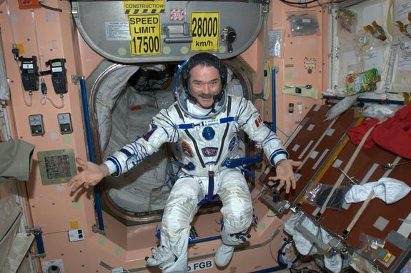 Canadian astronaut Chris Hadfield, Expedition 35 commander, poses in his Russian Sokol spacesuit while preparing for a May 13, 2013 landing on a Soyuz spacecraft.