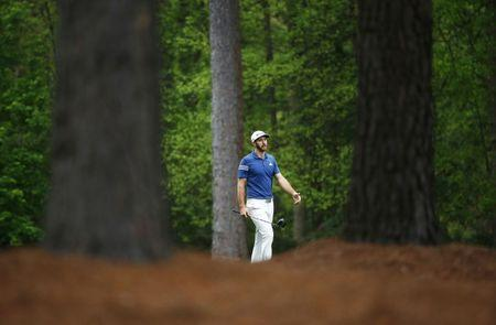 Apr 3, 2017; Augusta, GA, USA; Dustin Johnson walks down the fairway on the 11th hole during a practice round at The Masters at Augusta National GC. Mandatory Credit: Rob Schumacher-USA TODAY Sports