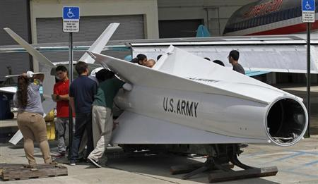 Miami area high school students at the George T. Baker Aviation school prepare to attach ailerons to a 41-foot surface-to-air Nike Hercules missile as they restore it at the school in Miami