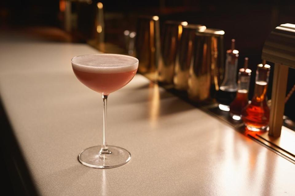 """<p>Diana, Princess of Wales was said to have a penchant for Bellinis, and <a href=""""https://urldefense.com/v3/__https://www.fourseasons.com/surfside/dining/restaurants/lido-restaurant/__;!!Ivohdkk!wfWqqVMv07PYzq_uXBeaUsSxL1pjl5jYGNE-jc_ZMSjdoXOvR-NUUW-e_MNuCu9OUQ$"""" rel=""""nofollow noopener"""" target=""""_blank"""" data-ylk=""""slk:Lido Restaurant & Champagne Bar"""" class=""""link rapid-noclick-resp"""">Lido Restaurant & Champagne Bar</a> at <a href=""""https://www.fourseasons.com/surfside/"""" rel=""""nofollow noopener"""" target=""""_blank"""" data-ylk=""""slk:Four Seasons Hotel at The Surf Club"""" class=""""link rapid-noclick-resp"""">Four Seasons Hotel at The Surf Club</a> in Miami pays homage to the beloved icon with this modernized take on the beverage.</p><p><strong>Ingredients:</strong><br></p><p>1 ounce fresh peach purée (about 1 peach freshly blended)</p><p>2 dashes Grapefruit bitters</p><p>4 ounces Prosecco</p><p>2 ounces Elderflower foam</p><p><strong>Directions:</strong></p><p>To make the foam: In an ISI cream siphon add 3 1/4 ounces lemon juice, 17 ounces Saint Germain, 13 1/2 ounces water and 5 gelatin sheets. Mix everything together until the gelatin sheets are dissolved. Add 2 ISI cream chargers and then dispense foam when ready.</p><p>To make the cocktail: Mix the peach, grapefruit bitters, and Prosecco in a mixing tin and stir gently and slowly, then pour in a coupe glass and finish with elderflower foam.</p>"""
