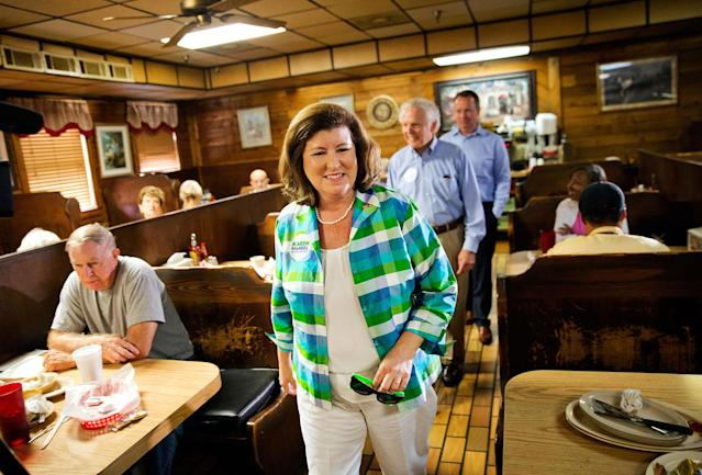 <p>Karen Handel, Republican candidate for Georgia's 6th congressional district greets diners during a campaign stop at Old Hickory House in Tucker, Ga., Monday, June 19, 2017. (Photo: David Goldman/AP) </p>