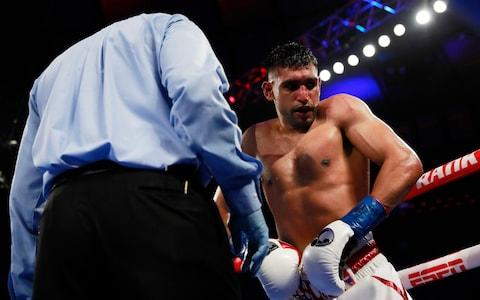 Amir Khan after a low-blow shot from Terence Crawford - Credit: action images