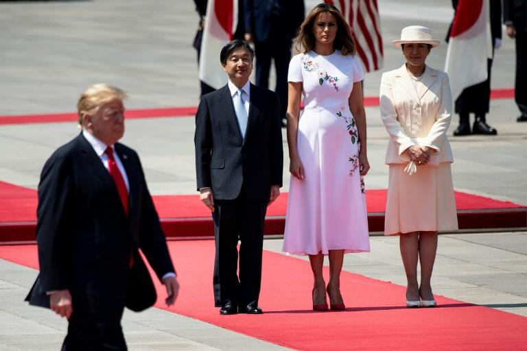 US First Lady Melania Trump, Japan's Emperor Naruhito and Empress Masako watch as US President Donald Trump inspects a guard of honour at the Imperial Palace in Tokyo