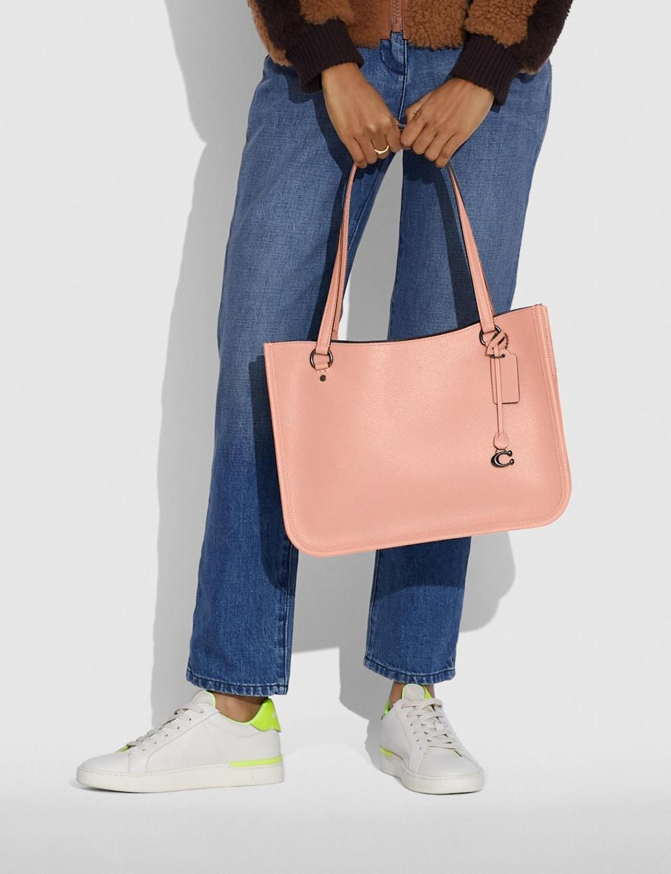 <p>You can fit so much in this <span>Coach Tyler Carryall Tote</span> ($350).</p>