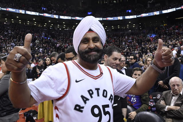 Toronto Raptors fan Nav Bhatia gestures before Game 1 of basketball's NBA Finals between the Golden State Warriors and the Toronto Raptors on Thursday, May 30, 2019, in Toronto. (Frank Gunn/The Canadian Press via AP)