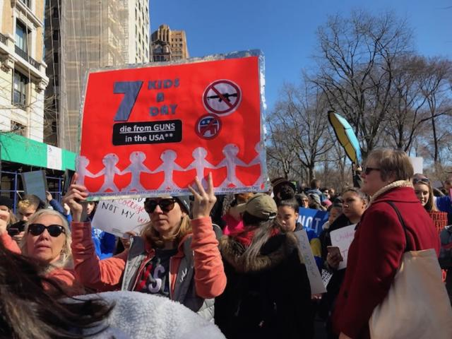 <p>A protester holds a sign in NYC. (Photo: Laura Kenney for Yahoo Lifestyle) </p>