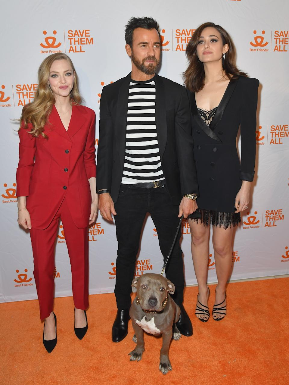 US actors Amanda Seyfried (L), Justin Theroux and his dog Kuma and Emmy Rossum (R) attend Best Friends Animal Society Hosts 4th Annual NYC Benefit To Save Them All at Guastavino's on April 2, 2019 in New York City. (Photo by Angela Weiss / AFP)        (Photo credit should read ANGELA WEISS/AFP via Getty Images)