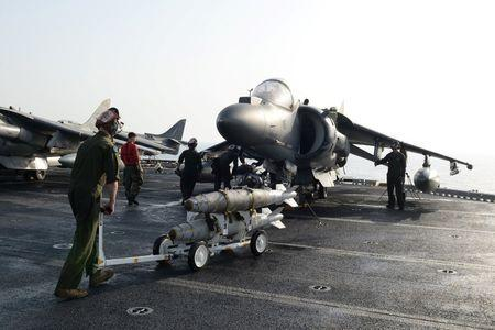 Marines prepare to load ordnance onto an AV-8B Harrier II on the flight deck of the amphibious assault ship USS Boxer in preparation for missions in support of Operation Inherent Resolve (U.S. military's operational name for the intervention against the Islamic State of Iraq and the Levant, ISIL), in the Arabian Gulf, June 16, 2016. Mass Communication Specialist 1st Class Brian Caracci/U.S. Navy/Handout via Reuters