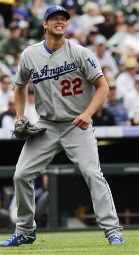 Los Angeles Dodgers starting pitcher Clayton Kershaw (22) reacts after throwing out Colorado Rockies' Troy Tulowitzki during the sixth inning of a baseball game, Wednesday, May 2, 2012 in Denver. The Rockies won 8-5. (AP Photo/Barry Gutierrez)
