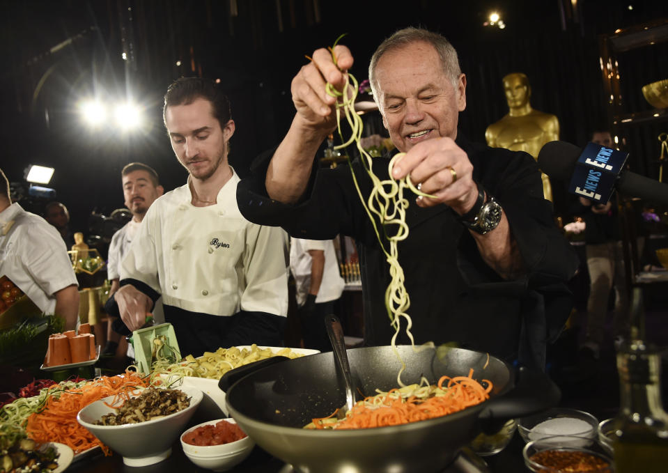 "FILE - Chef Wolfgang Puck right, and his son Byron make a pasta dish at the Governors Ball Press Preview for the 92nd Academy Awards in Los Angeles on Jan. 31, 2020. A new four-part documentary series, ""The Event,"" shows the intense planning and details that go into high-profile catering. The series premieres on HBO Max on Jan. 14. (AP Photo/Chris Pizzello, File)"
