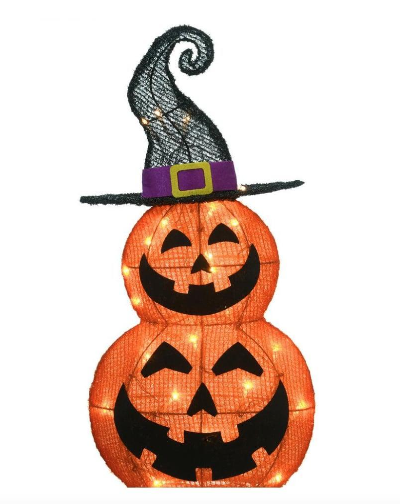 """<p>Unleash the <a class=""""link rapid-noclick-resp"""" href=""""https://www.popsugar.com/Halloween"""" rel=""""nofollow noopener"""" target=""""_blank"""" data-ylk=""""slk:Halloween"""">Halloween</a> spirit with the <span>Pre-Lit Stack Pumpkins</span> ($43). Just shy of two feet tall, this decor piece can be displayed on any flat, covered surface. Then, repackage it, and bring it back out next year.</p>"""