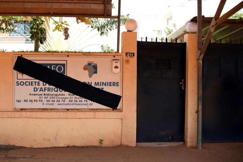 FILE PHOTO: The sign of Canadian gold miner Semafo is pictured covered in black in memory of the victims of an attack on a road leading to the Boungou mine, operated by the company, at its headquarters in Ouagadougou